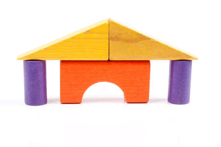 Toy blocks stacked like a house with pillars Stock Photo