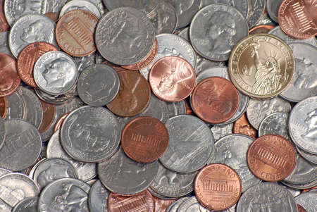 Loose change with a dollar coin