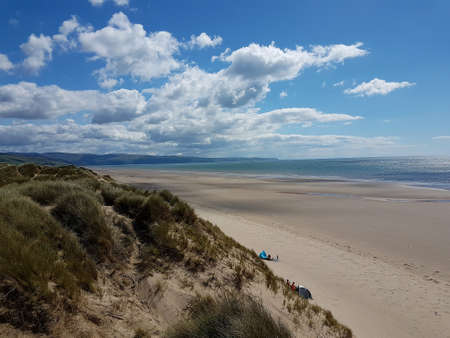 Landscape scene of Talybont beach and sand dunes in North Wales on a summer day. Imagens