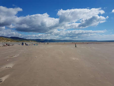 Beach landscape scene in Talybont, North Wales on a summer day.