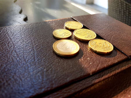 Close up shot of euros left as a tip in a restaurant. Imagens