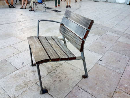 Close-up shot of a weathered street bench on the promenade in Sitges, Spain. Imagens