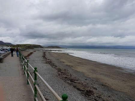 Criccieth, Gwynedd, Wales, UK - August 27, 2018: Promenade scene on a cloudy day in Criccieth, North Wales.