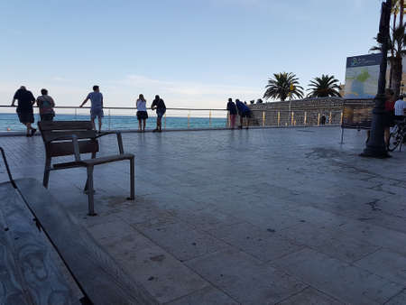 Sitges, Spain - September 23, 2018: Early evening promenade scene in Sitges, Spain. Editorial