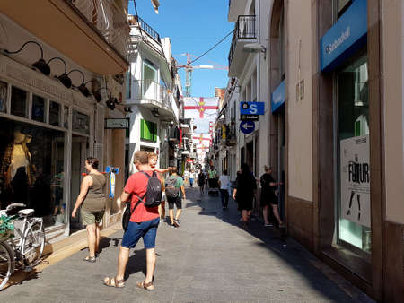 Sitges, Spain - September 24, 2018: A view of a busy Sitges town street.