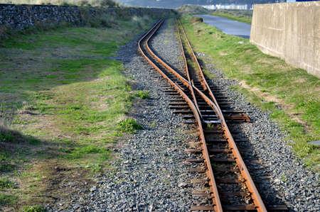 Narrow gauge train track Fairbourne railway.