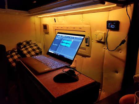 North Wales, United Kingdom - 01/21/2019: Remote working setup in a motorhome.