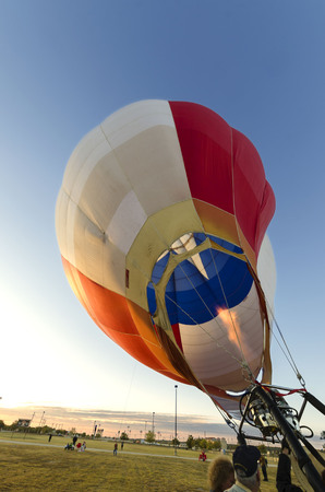 a Texas hot air balloon inflates in preparation for its morning flight