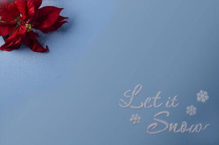 Let it snow written in snow on blue Stock Photo