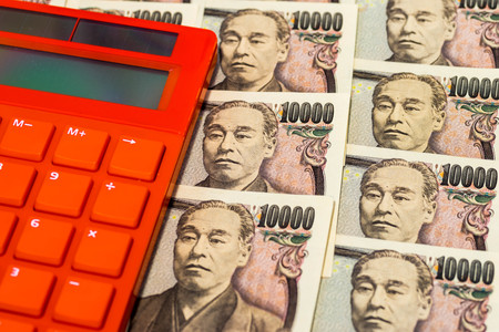 Japanese banknotes with colorful calculator