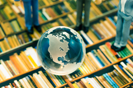 Crystal globe on book shelf image