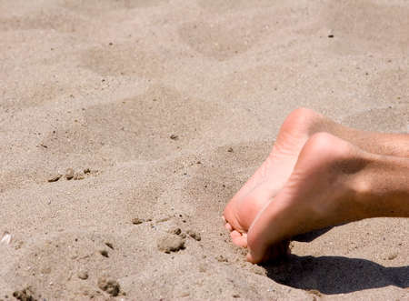 dirty feet: feet in the sunshine on the beach