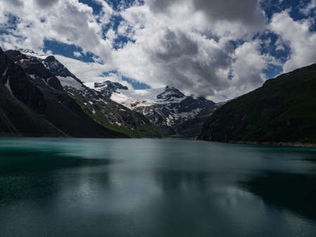 Scenic view on Mooserboden See near Kaprun, Austria, Europe. National park Hohe Tauern. Charming lake with amazing deep colorful water and glaciers above it. Favourite destination for holidays.