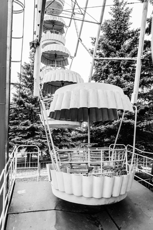 wheel spin: Monochrome photo of ferris wheel in the old amusement park