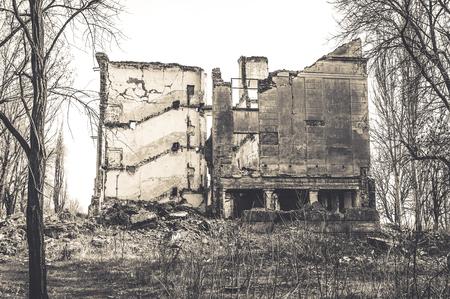 earthquake crack: Ruined school building. Monochrome photo Stock Photo