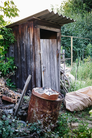 Old wooden toilet in village.