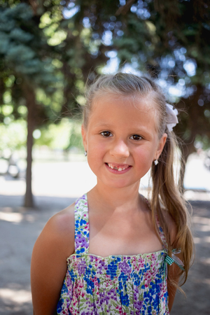 Portrait of smiling little girl without one tooth
