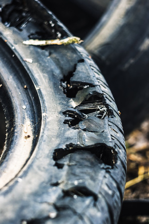 A bunch of old tires from used cars. Environmental pollution. Dump tires Фото со стока
