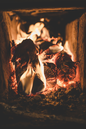 The process of burning wood in the stove.