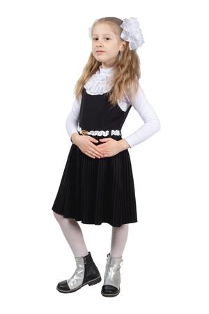 Little cute schoolgirl posing on a white background