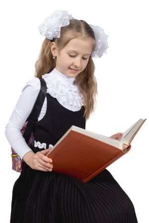 Little cute schoolgirl posing on a white background Stock Photo