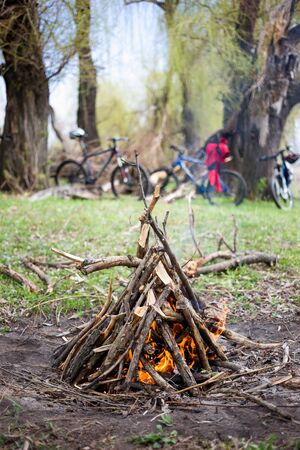 Bonfire and bikes in the background. The concept of a healthy lifestyle and leisure with a bicycle