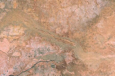 Cracked and peeling paint old wall background. Classic grunge texture Standard-Bild - 133666509