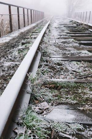 Rails in hoarfrost. Misty autumn morning