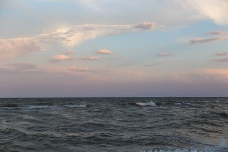Sea landscape with waves on the water in pastel colors. Stockfoto