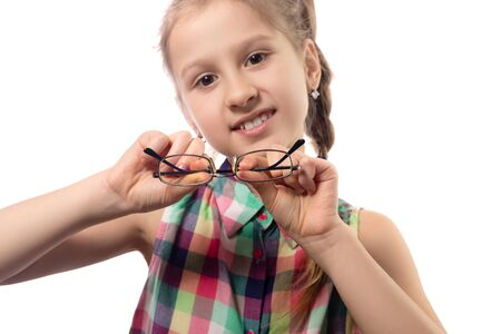 Cute little girl with glasses on white background. Studio shot.
