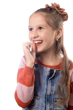 Portrait of little girl with orthodontics appliance isolated on white background. Stok Fotoğraf