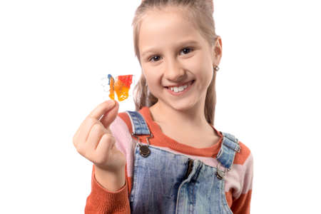 Portrait of little girl with orthodontics appliance isolated on white background. Stock fotó