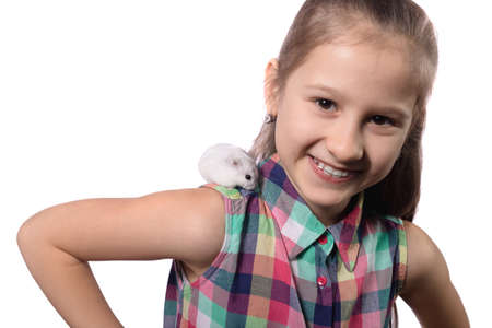 Cute little girl with white hamster isolated on white background Stock fotó