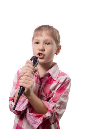 Little cute girl singing into a microphone isolated on a white background