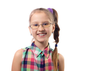 Little cute girl in glasses posing on a white background. Child with poor vision