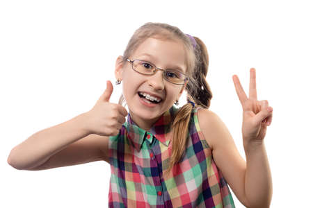 Cute little girl in glasses for vision poses on a white background. Studio shot.