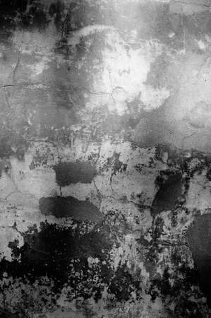 Cracked and peeling paint old wall background. Monochrome classic grunge texture