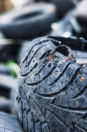 A bunch of old tires from used cars. Environmental pollution. Dump tires Standard-Bild