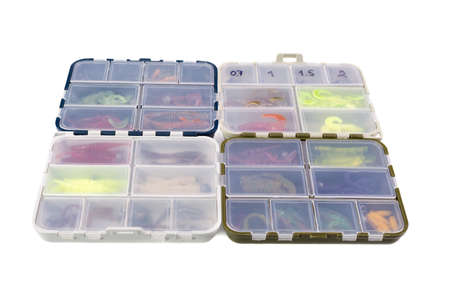Transparent boxes with silicone fishing lures isolated on white background