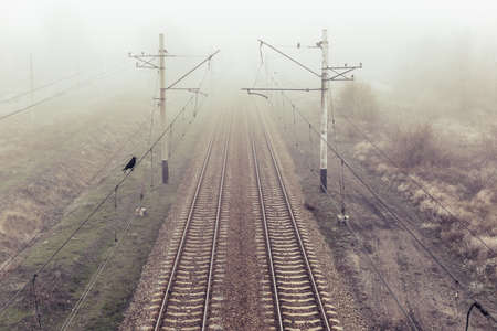 Misty morning view of railway in autumn. Top view
