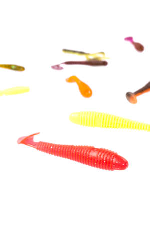 Multicolored silicone baits isolated on white background. Studio photo.