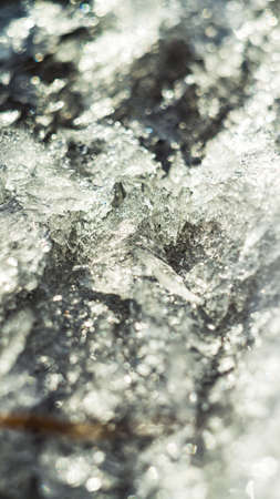 The first ice on the bank of a muddy reservoir in winter. Background for design. Photo taken with a Soviet manual lens.