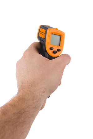 A man holds a yellow-black pyrometer. A device for non-contact temperature measurement. Studio photo of the subject isolated on white background. Standard-Bild
