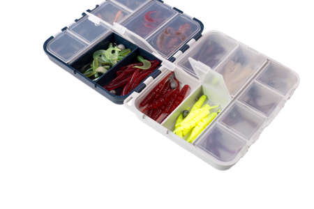 Transparent box with silicone fishing lures isolated on white background