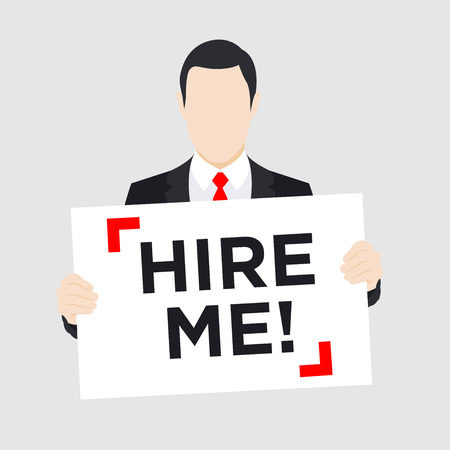 Man in suit holding Hire Me Sign