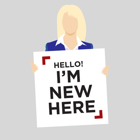 Blond woman in suit holding Hello Im New Here Sign
