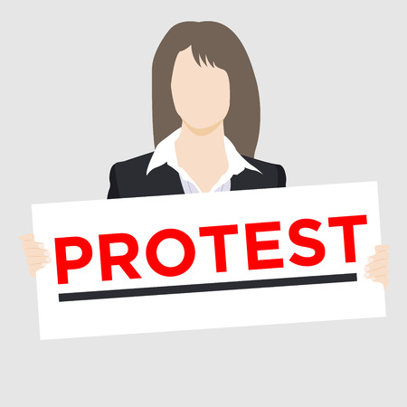 White woman in business suit holding protest sign