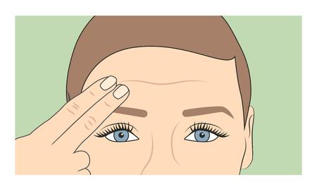 Frau, die mit den Fingern den Beginn von Falten und Alterung zeigt