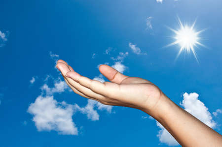 Hand on sky photo