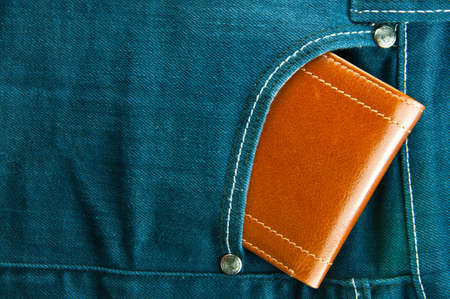 Blue jeans pocket with brown wallet photo
